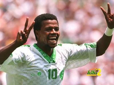 29 JUN 1994: SAEED OWAIRAN OF SAUDI ARABIA CELEBRATES DURING SAUDI ARABIA's 1-0 VICTORY OVER BELGIUM IN A 1994 WORLD CUP MATCH AT RFK STADIUM, WASHINGTON D.C. Mandatory Credit: Billy Stickland/ALLSPORT